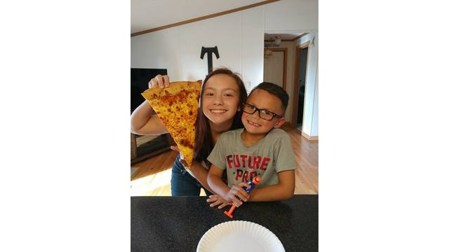 11-14-17 My son and daughter enjoying a slice of pizza from our new local pizza place big dam pizza from Amanda Williams.jpg