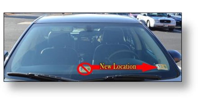 Vehicle inspection stickers to change spot on windshield