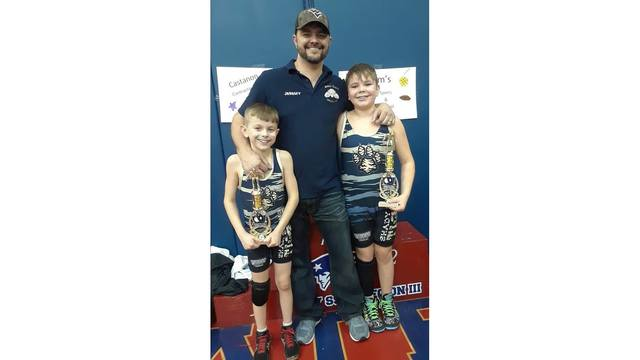 4-6-18 My husband and 2 boys after they both won 1st place in a wrestling tournament from Mandy Woods_1523025209409.jpg.jpg