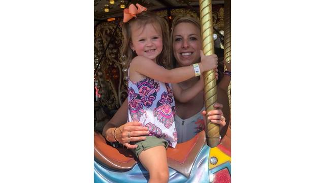 Me and my daughter Penelope on the carousel from Ashley Knight_1534188855813.jpg.jpg