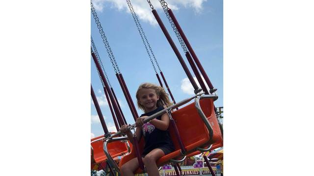 My daughter Leigha riding the swings from Brittany Lane_1534188857352.jpg.jpg
