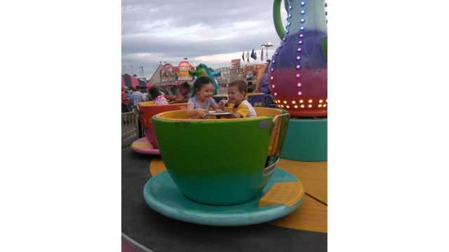 My daughter Taylor Scarbro and her cousin Easton Aliff having a blast on the tea cups from Holly Scarbro_1534188857886.jpg.jpg
