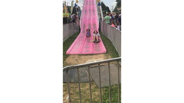 My daughters Katie & Izzy going down the slides - One of theirs favorites from Rebecca Wilson_1534188858960.jpg.jpg