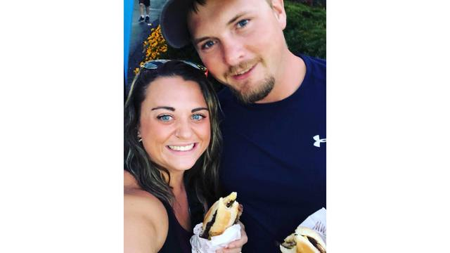 My husband Damion and I enjoying our ribeye steak sandwiches from Brittany Lane_1534188861372.jpg.jpg