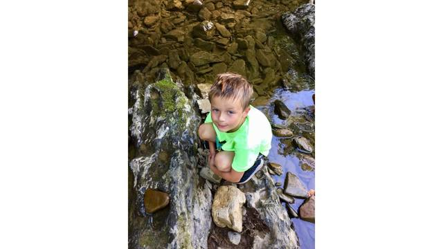 8-12-18 My son Gage playing at The Rock swimming hole and catching crawfish from Tessa Webb_1534263224545.jpg.jpg