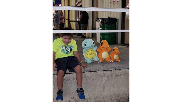 Aidan 8 years old. Playing with ther pokemon he won from Saundra Bostic_1534282117664.jpg.jpg