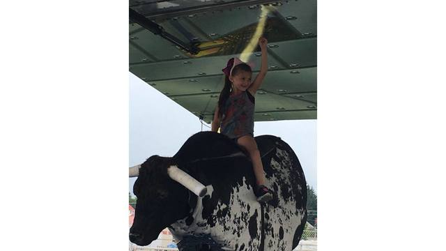 Brooklyn trying to conquer the mechanical bull from Jimmy Walkup_1534282104163.jpg.jpg