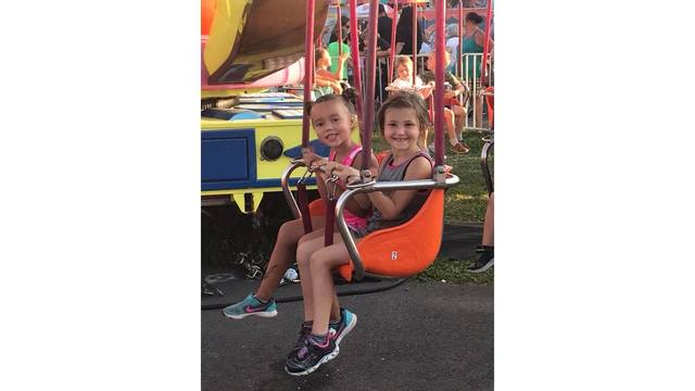 Cousins Kennedy and Brooklyn having a blast on the swings from Rachel Walkup_1534282016739.jpg.jpg