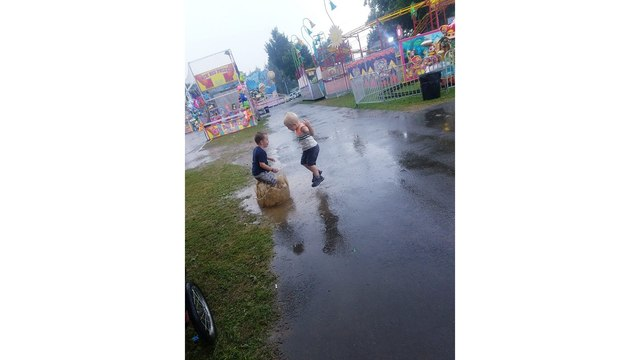 Lucas and Kaeson enjoying the fair despite the rain from April Alderman_1534282001107.jpg.jpg