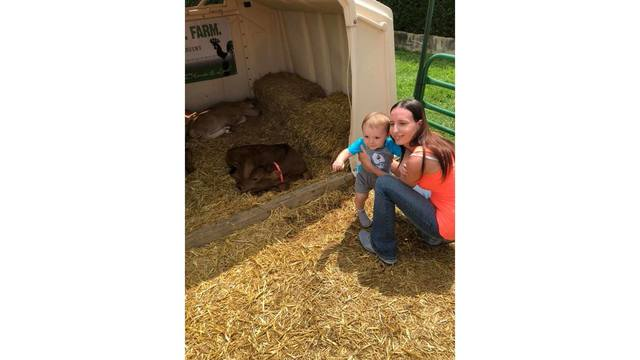 Me and my son Zander with the baby cows from Jessica Cain_1534281991732.jpg.jpg