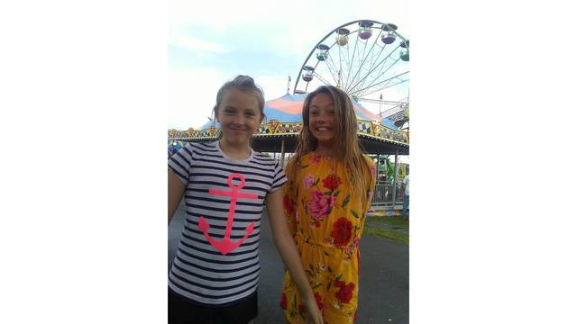 My Daughter Krisanna Elmore her friend Hayleigh Hartenstein waiting in line to ride from Susan Reed_1534281976305.jpg.jpg