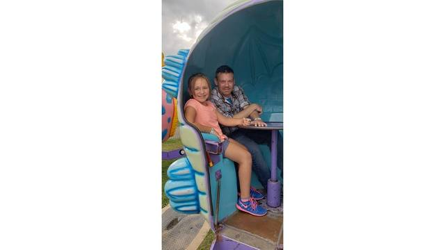 My daughter and my brother getting ready to ride the dizzy dragon from Brandy N Seth Bostic_1534281988085.jpg.jpg