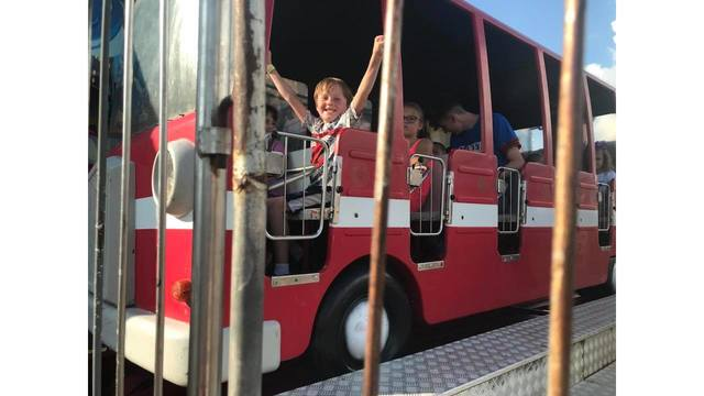 My kid on the fire truck from William Grubbs_1534282126108.jpg.jpg