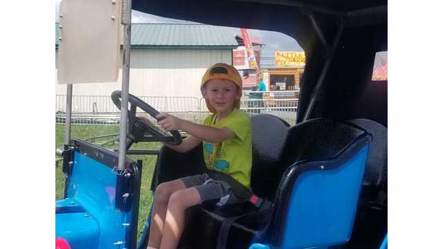 My son Westley cruising on a carnival ride from Holly Ridpath_1534282104157.jpg.jpg