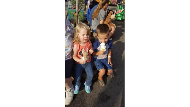 My son and daughter eating ice cream cone in midway after riding ride from Shelley Weikle_1534282131426.jpg.jpg