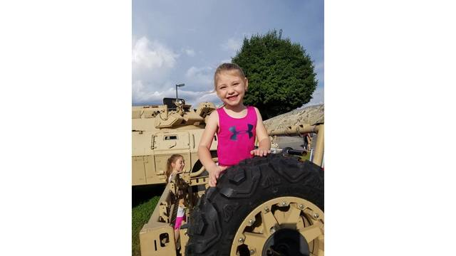 My youngest daughter Emilee on the military vehicle and her sister Morgan from Angie Brammer_1534282136953.jpg.jpg