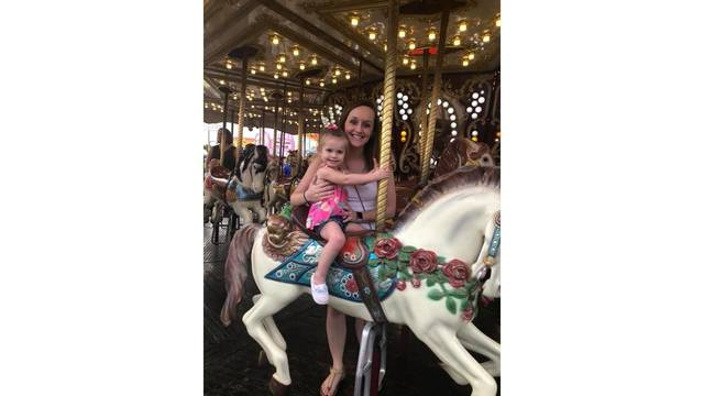 Peyton and Amanda on the carousel Christina Allen_1534282121676.jpg.jpg