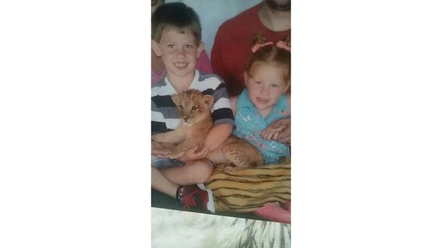 8-25-18 Austin and Lilly Nida with a real baby lion from Samantha Walton-Nida_1534522873705.jpg.jpg